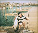 Joe Reynolds back at the dock at Shantytown in Ocean City, Maryland with a yellowfin tuna. Early 80s.