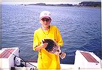Young man with a flounder caught in South Bay near Ocean City, Maryland.