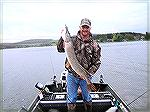 Eric Richter shows a nice Deep Creek Lake pike caught in May 2013. Photo by Eric Richter.